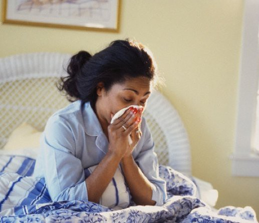 Sick Woman in Bed --- Image by © Tom Stewart/CORBIS