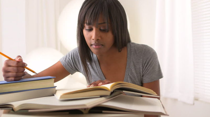 black woman reading